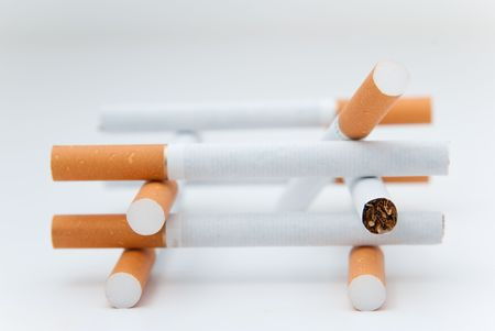malign: cigaretes isolated over a white background