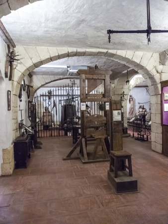 Holding cell in a medieval prison, with torture instruments Stock Photo - 16102580