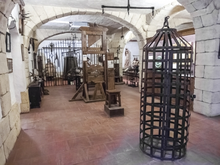 guillotine: Holding cell in a medieval prison, with torture instruments