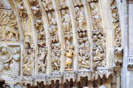 french ethnicity: sculptures and reliefs at the entrance to the cathedral of Notre Dame in Paris