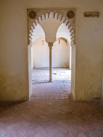 cid: Moorish arches in the Alcazaba of Malaga