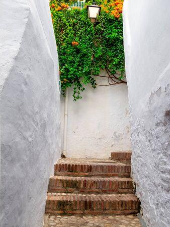 Alley with stairs in frigiliana, Malaga.
