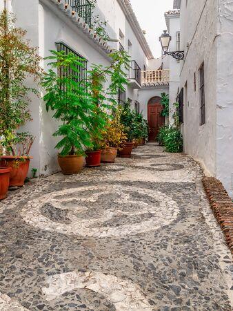Typical alley of Frigiliana, housing aloft.