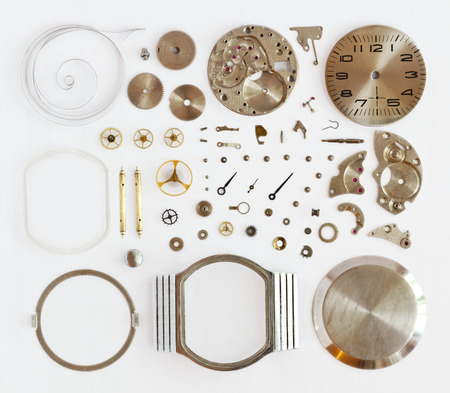disassembled mechanical watches on a white background Фото со стока