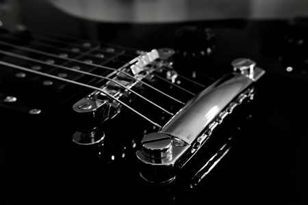 The guitar bridge with six strings and humbucker Stock Photo