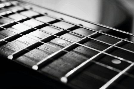 De eindeloze snaren van een elektrische gitaar Stockfoto