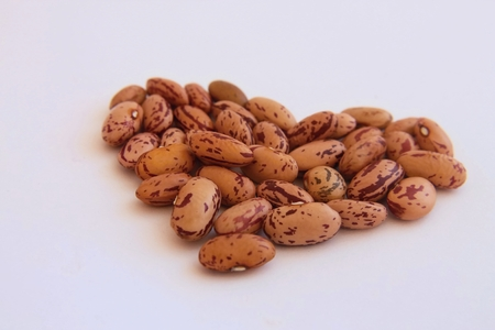 roman beans: Orange beans on white background with heart shape