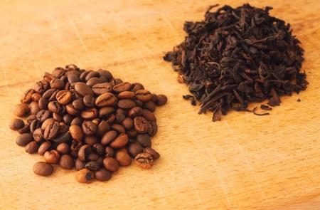 Heap of coffe grains on wooden board photo