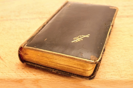 Old worn Prayer book on the wooden board  photo