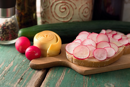 Picture of bread slice with butter and cut radishes.  photo