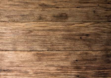 Photo of old worn wooden board with interesting texture of wood material Standard-Bild