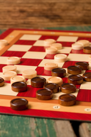 Vertical Photo Of Wooden Stones On Board For Game Of Checkers Inspiration Game With Stones And Wooden Board