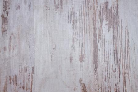 madera r�stica: Foto horizontal con tablero de madera con textura agradable creado por el color blanco muy desgastado con lagunas donde la madera es visible.