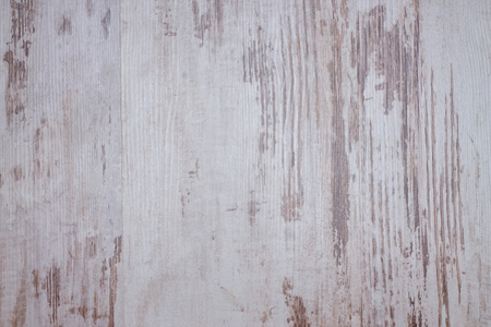 grunge wood: Horizontal photo with wooden board with nice texture created by very worn white color with gaps where the wood is visible. Stock Photo