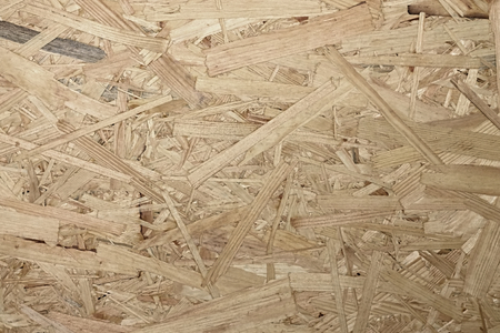 osb: Horizontal photo with a texture of wooden OSB board which consists of sawdust and shavings.