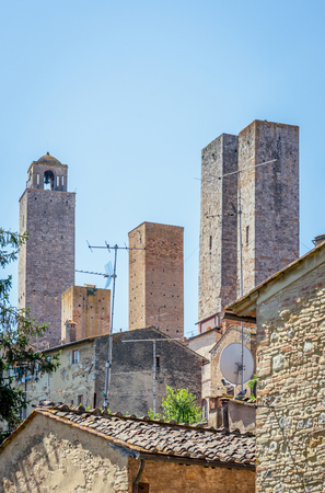 Vertical photo with view on very famous and ancient ancestral family towers in town San Gimignano.