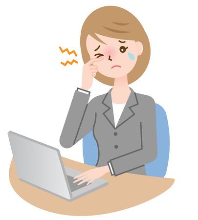 vermoeide ogen zakenvrouw op haar bureau