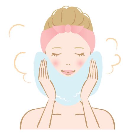 donna applicare asciugamano caldo per il trattamento sul suo volto