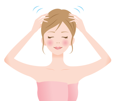 Beautiful smiling woman performing a self head massage with her fingertips