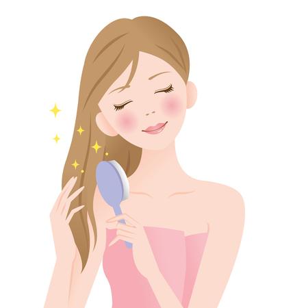 Giovane donna che spazzola i suoi capelli lunghi isolati su fondo bianco.