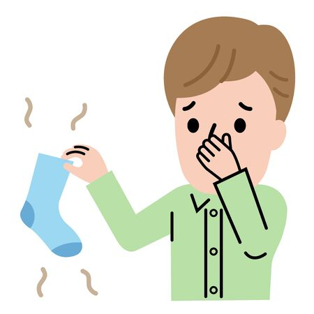 young man holding smelly socks and clogged nose. Health care and hygiene concept