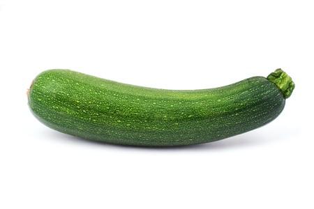 vibrat color: Green squash (zucchini) on white background. Stock Photo