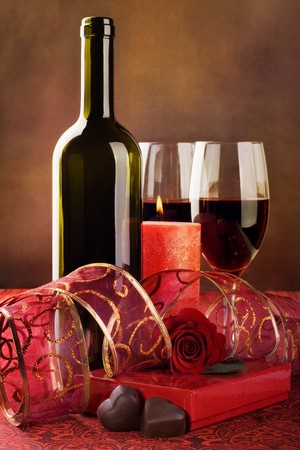 Red wine, candle and chocolate hearts. Still life  photo