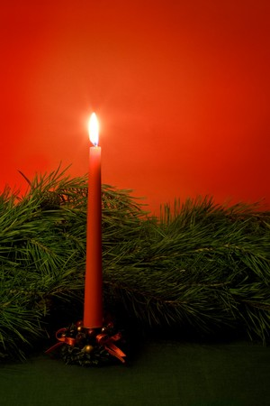 Christmas candle and pine branch. Still life. photo