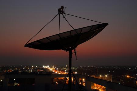Telecomunication satellite dish over Twilight background Stock Photo