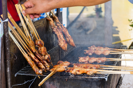 Grilled chicken with smoke, a delicious menu which easy to find in local market Stock Photo