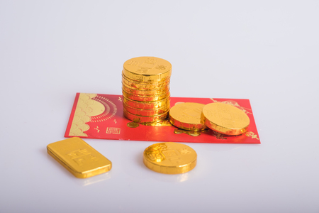 traditional custom: gold coins and red envelopes Stock Photo
