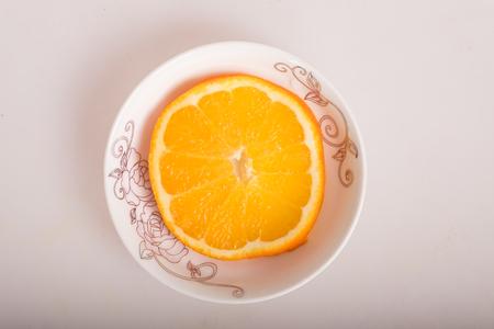 half  cut: Close up to a half cut orange in a plate