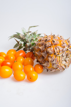 cherry tomatoes: Pineapple and cherry tomatoes Stock Photo