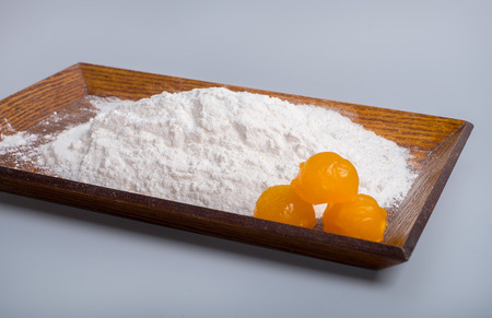 yolks: Yolks in a plate filled with flour