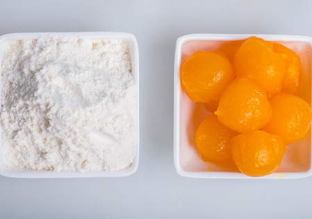 yolks: Yolks and flour in a plate