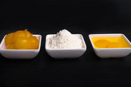 yolks: Egg yolks, eggs and flour in 3 separate plate