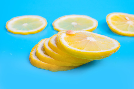 icecube: lemon slices on blue background Stock Photo