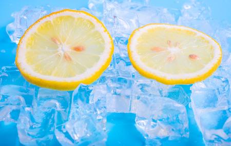 icecube: lemon slices on blue background with ice cubes Stock Photo