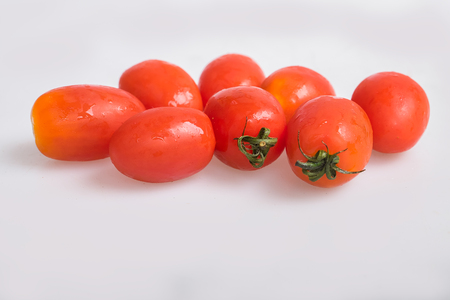gules: tomatoes on white background