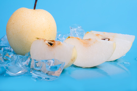 icecube: pears with ice cubes on blue background Stock Photo