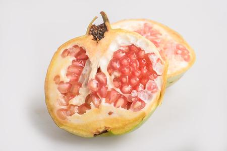 juicing: pomegranates on white background
