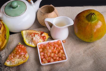 gules: pomegranate with tea set