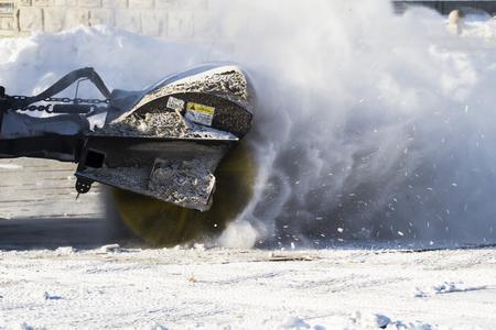Machine on the snow ground