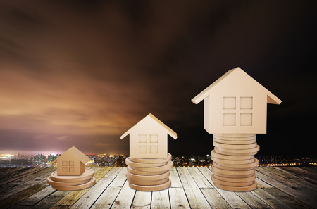 ascendant: Housing economy and gold coins Stock Photo
