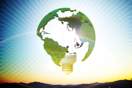 Energy saving lamp and earth Standard-Bild