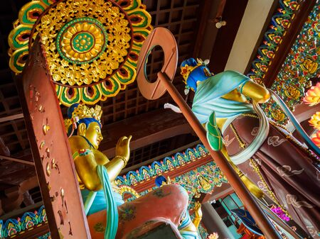 Grand gold painted statue of Buddha with elaborate carvings at Nanshan temple in Hainan, China. Stock Photo