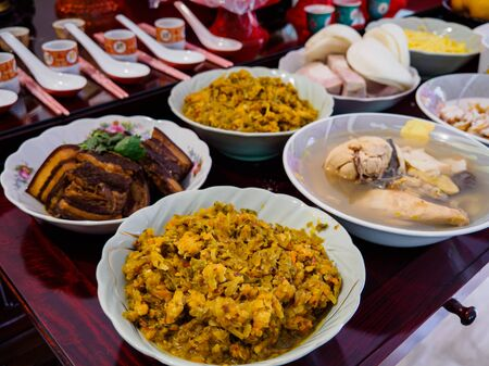 Asian Chinese ancestor worship prayers - food offerings made to pray to ancestors on Dongzhi / Winter solstice