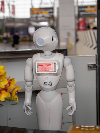 GUANGZHOU, CHINA - 9 OCT 2019 - A smart passenger service robot at Guangzhou Baiyun Airport. The robots provide flight information, navigation and other services. Humanoid robots theme