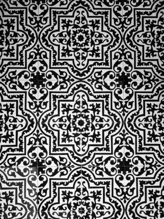 Azulejo decorative floor tiles form a monochrome abstract background texture Фото со стока