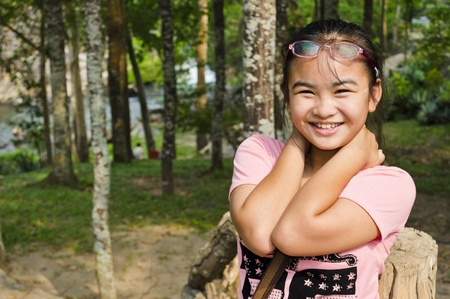 Young girl smiled happily in the forest photo